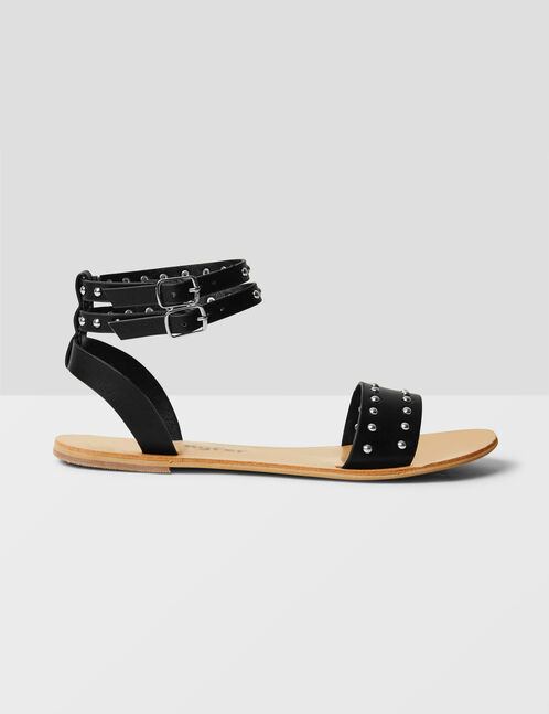 Flat black sandals with stud detail