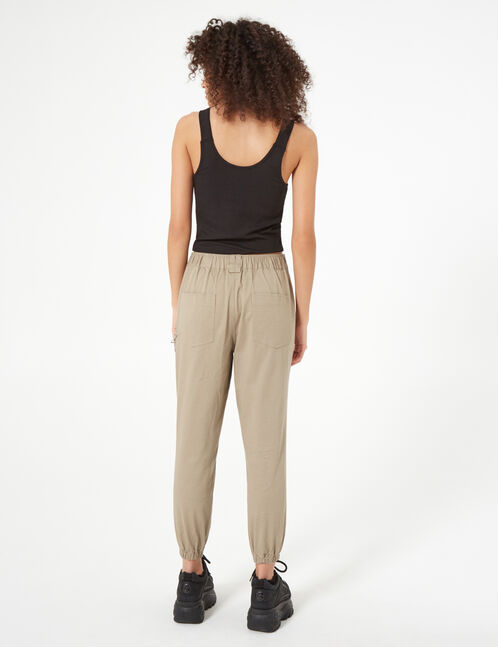 Beige trousers with chain detail