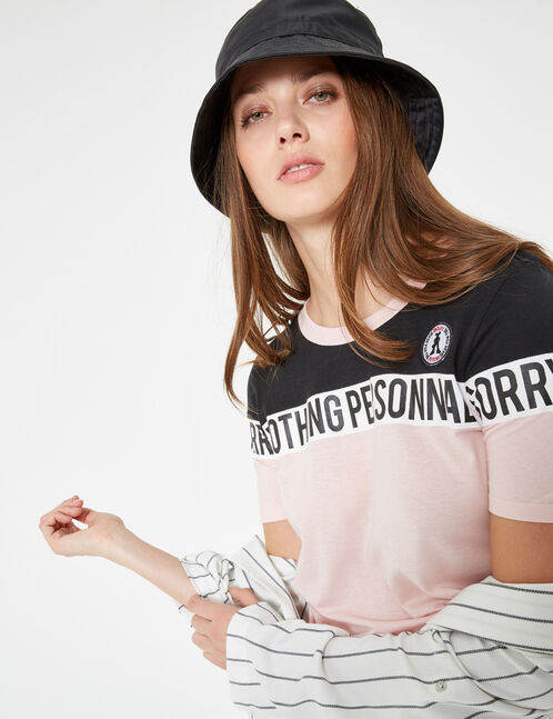 Light pink and black T-shirt with text design detail