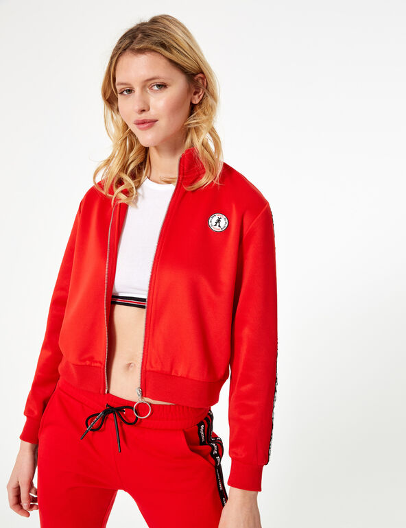 Red zip-up sweatshirt with trim detail
