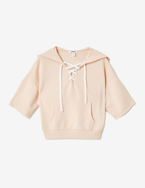 Light pink hoodie with lacing detail