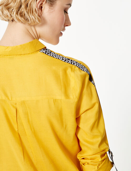 Ochre shirt with text design trim detail