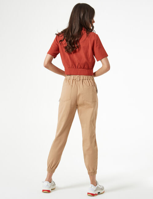 beige cargo trousers with chain
