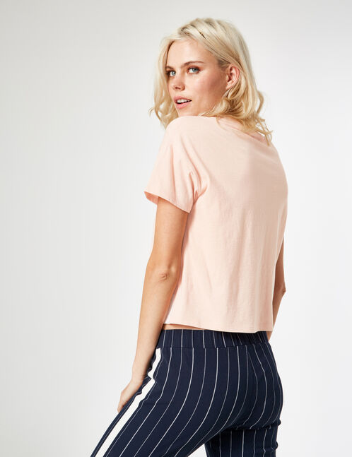 Light pink T-shirt with text design detail
