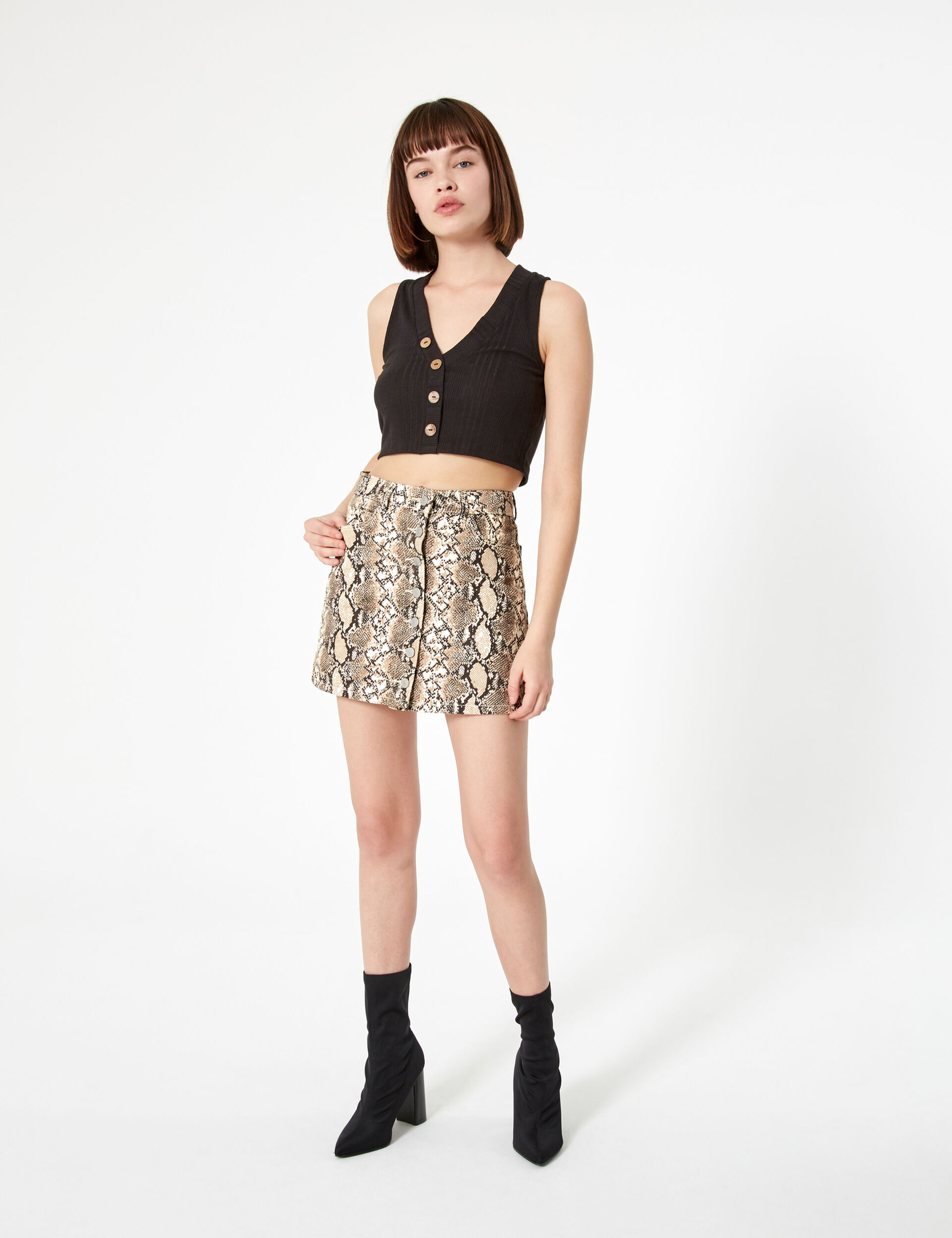 Beige and black button-up skirt with python print detail