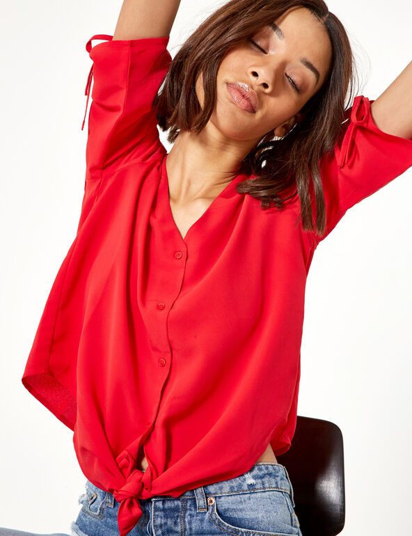 Red blouse with gathered sleeve detail