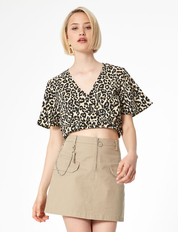 Beige skirt with chain detail