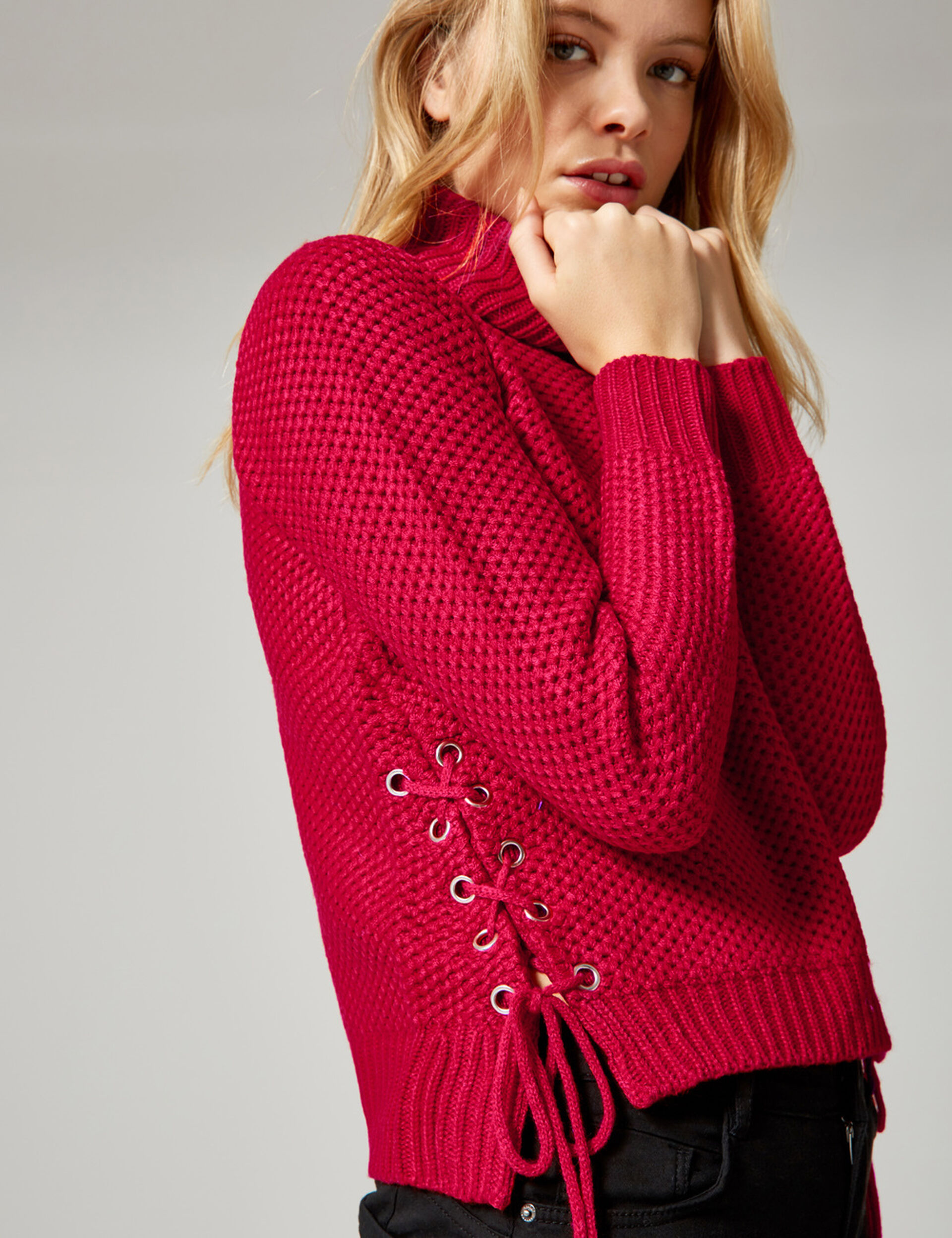 Red textured jumper with lacing detail
