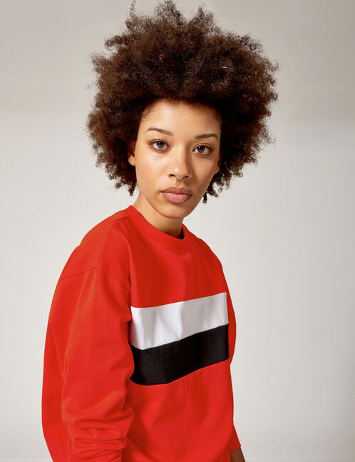 Red, black and white sweatshirt with trim detail