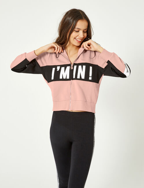 Light pink and black zip-up hoodie with text design detail
