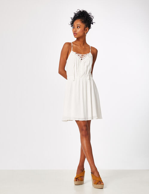 Cream dress with lace and lacing details
