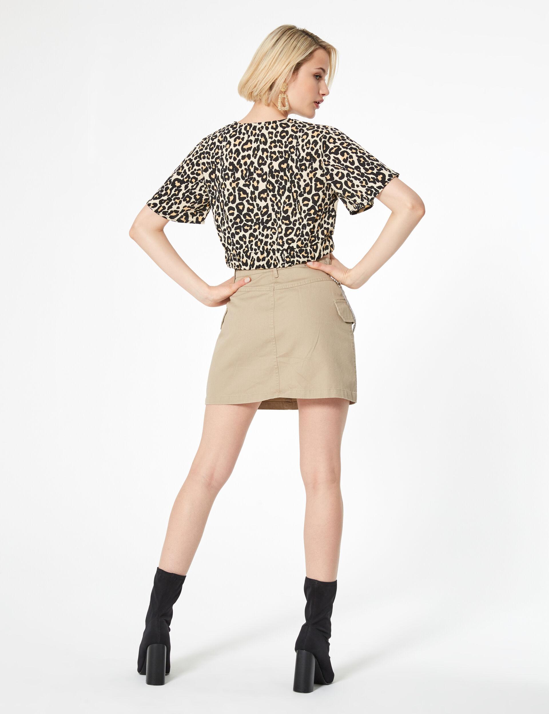 Beige and black leopard print wrap blouse