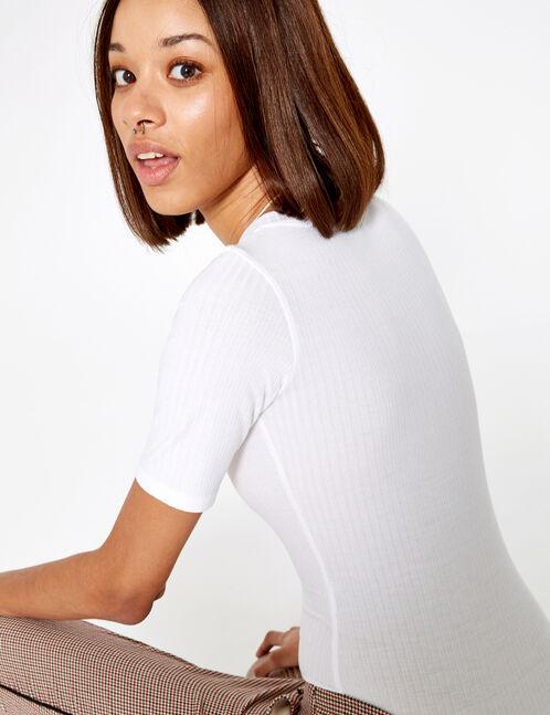 White buttoned bodysuit