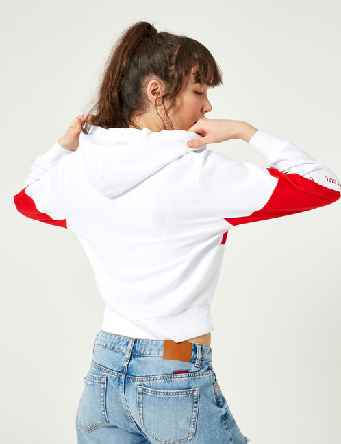 White and red zip-up hoodie with text design detail