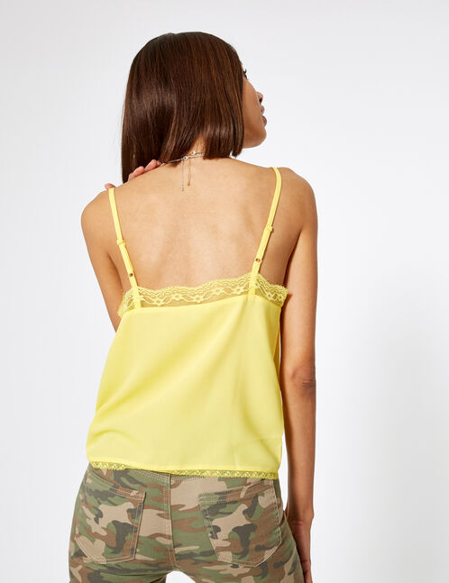 Pale yellow blouse with lace detail