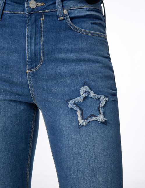 Medium blue skinny jeans with star detail