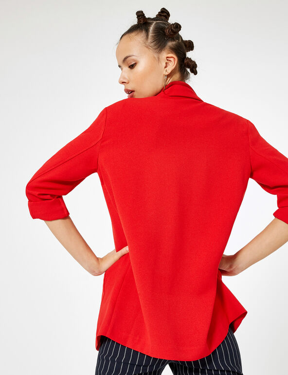 Red blazer with roll-up sleeves
