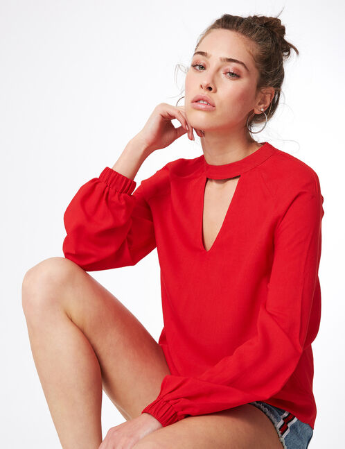 Red blouse with open detail